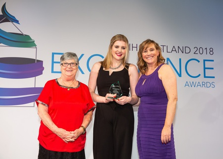 Rhona collecting her award at the CIH Scotland Annual Awards 2018